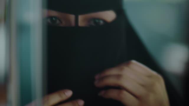 Confidence Muslim woman Adjusting Her Hijab