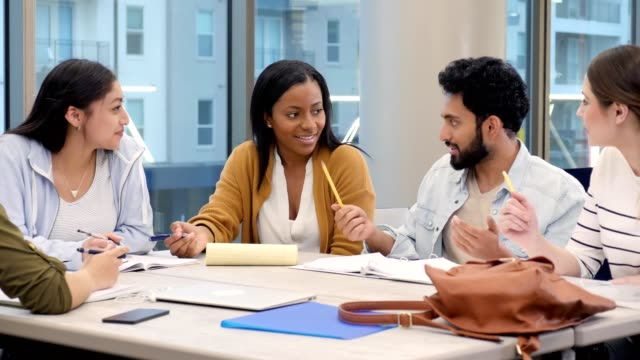 confident african american female college student leads study group - studente universitario video stock e b–roll