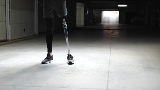 Confident Amputee Athlete Man Portrait OF Confident Amputee Athlete Man In Parking Garage Before Sports Training prosthetic equipment stock videos & royalty-free footage