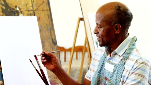 Confident artist holding paintbrush 4k video