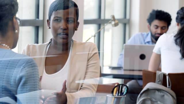 Confident bank employee discusses banking services with customer