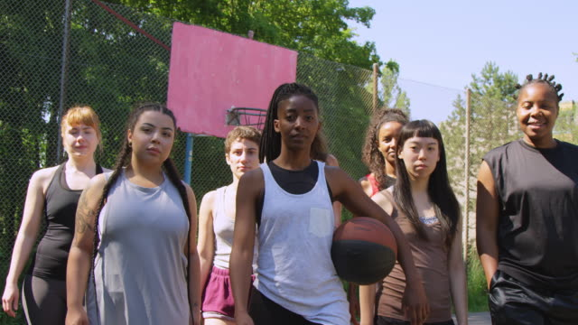 confident basketball team walking on sports court - body positive video stock e b–roll