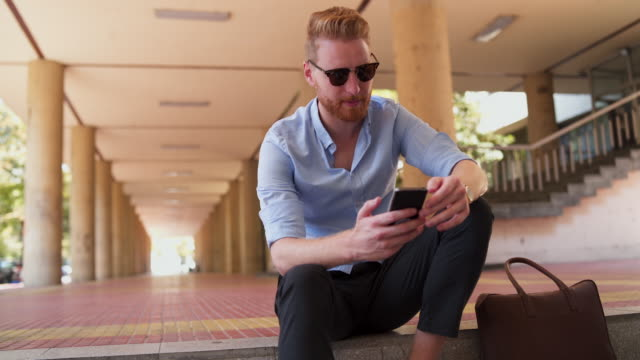 Confident businessman have a video conference Modern redhead businessman, have a video call with his client redhead stock videos & royalty-free footage