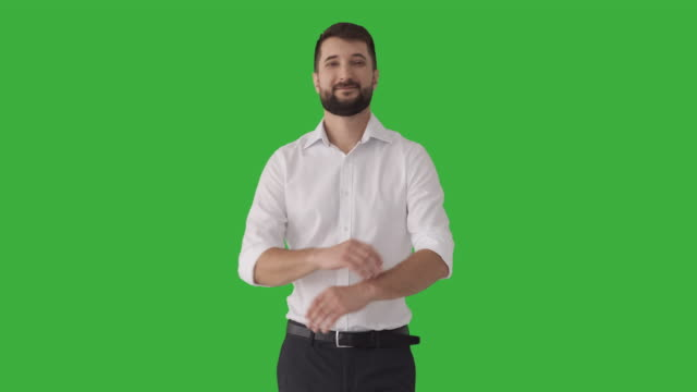 Confident businessman over green background video