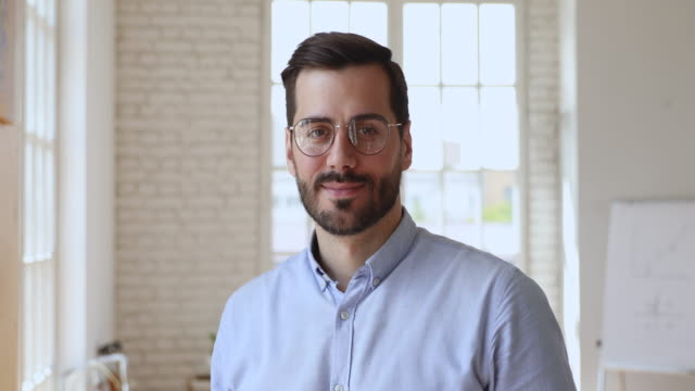 Confident businessman wear glasses looking at camera, business portrait