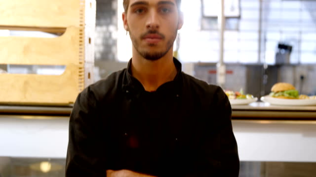 Confident chef standing in commercial kitchen 4k video