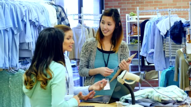Confident clothing store owner or manager trains new employees video