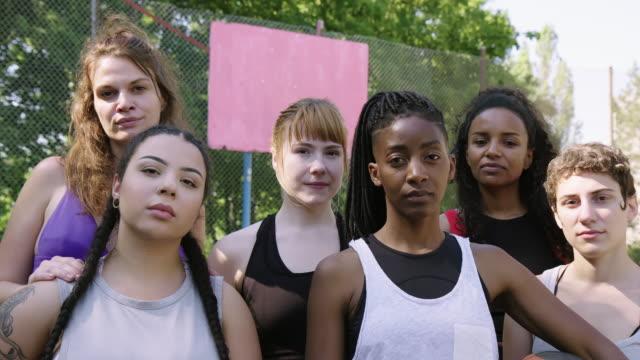 confident female basketball team at sports court - amicizia tra donne video stock e b–roll