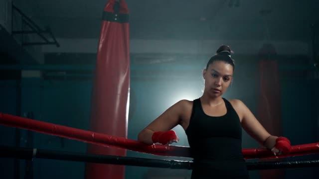 confident female boxer's look - potere femminile video stock e b–roll
