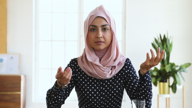 Confident indian muslim business woman speaking looking at camera