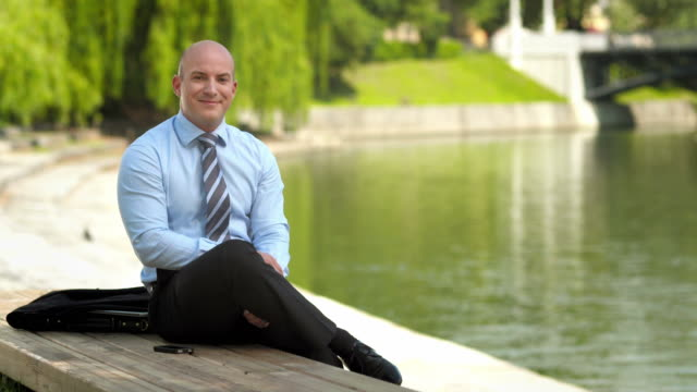 HD: Confident Manager Posing By The City River video
