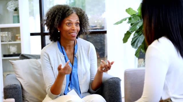 Confident mature therapist encourages teenage girl video
