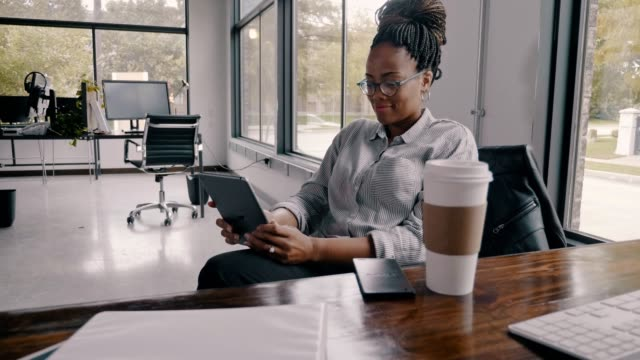 Confident mid adult African American businesswoman taking a coffee break