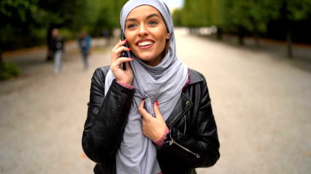 Confident Muslim woman  talking on phone video