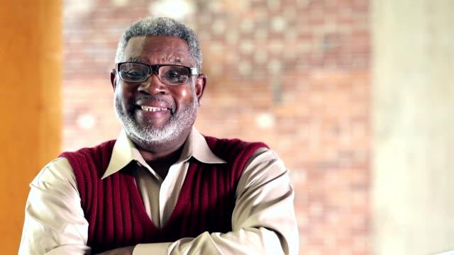 Confident senior African-American man in sweater vest