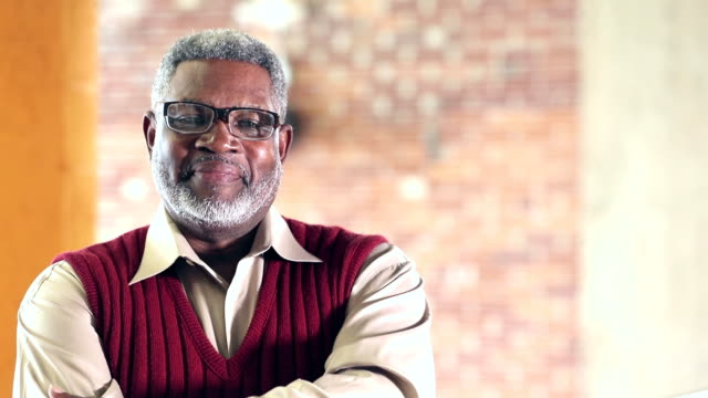 Confident senior African-American man in sweater vest