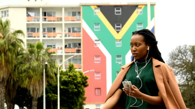 Confident South African Woman Businesswoman with the South African flag in the background cape town stock videos & royalty-free footage