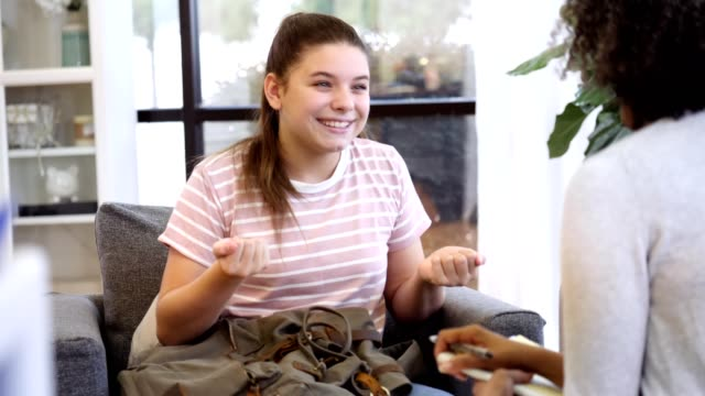 Confident teenage counseling patient discusses improvements with counselor video