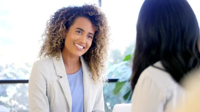 Confident therapist advises female patient Confident mixed race female therapist gestures while encouraging and giving advice to female patient. The patient attentively listens to the therapist. job interview stock videos & royalty-free footage