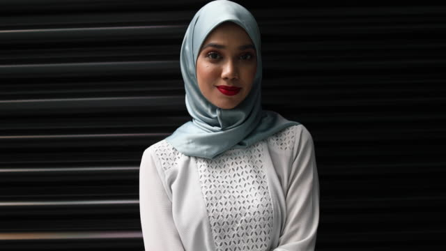 confident young muslim woman - etnia malese video stock e b–roll