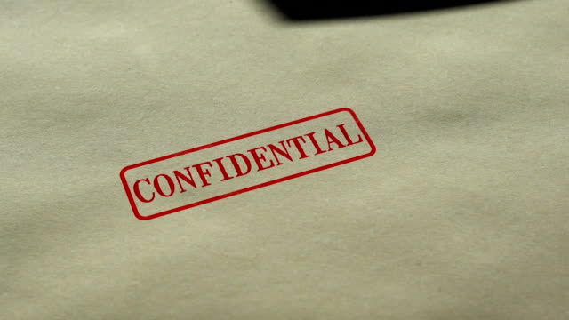 Confidential seal stamped on blank paper background, personal data nondisclosure