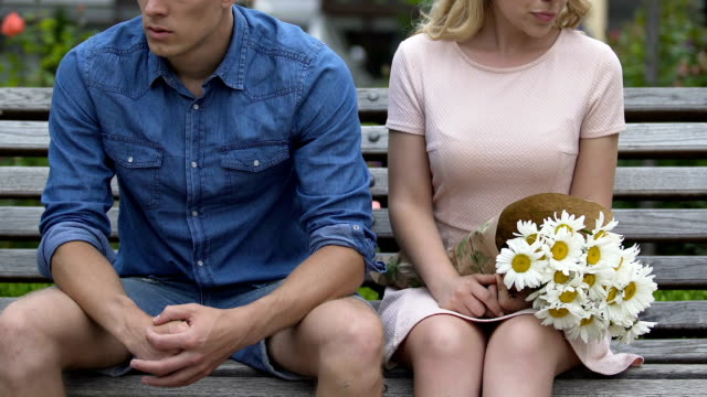 Conflict between stressed man and woman, girl throwing bouquet and going away Conflict between stressed man and woman, girl throwing bouquet and going away relationship breakup stock videos & royalty-free footage