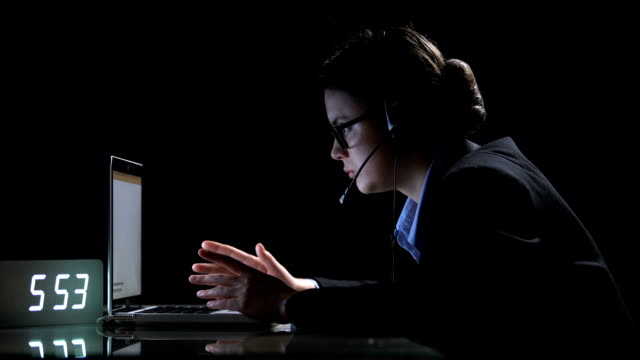 confused support service female worker searching for information checking errors - shifts call centre video stock e b–roll