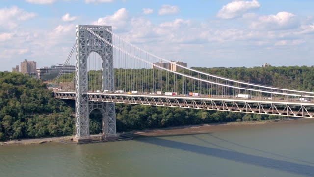 AERIAL: Congested traffic on highway suspension bridge leading to New York City video