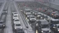 istock LD Congestion on the highway underpass in a snow storm 1136768160