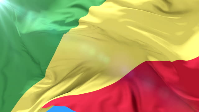 Congolese flag waving at wind with blue sky in slow, loop video