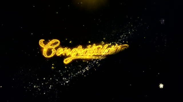 congratulations written gold particles exploding fireworks display - congratulations stock videos & royalty-free footage