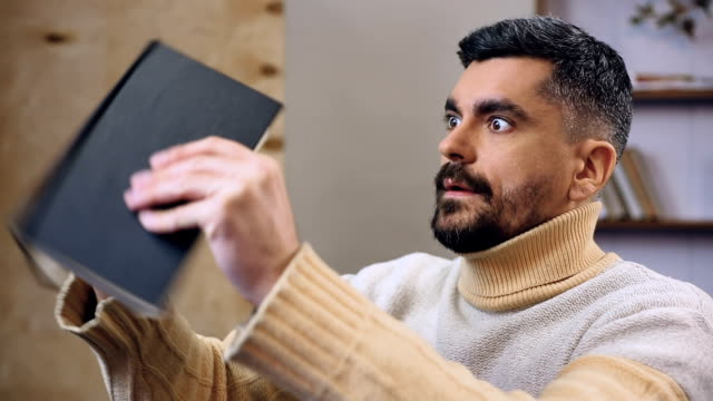 Conservative man frantically looking for his money stash among books, savings video