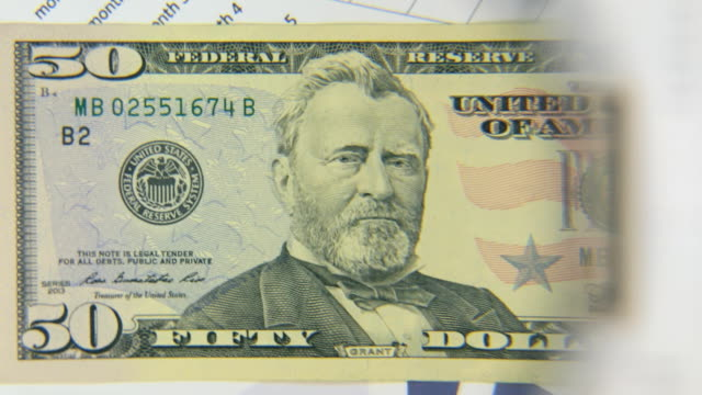 Consider a banknote of fifty dollars, an increase with a magnifying glass video