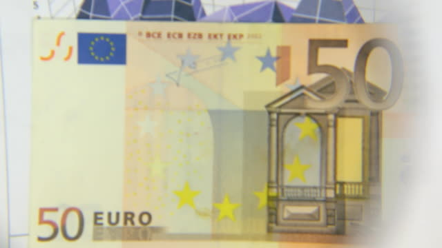 Consider a banknote of fifty euros, an increase with a magnifying glass video