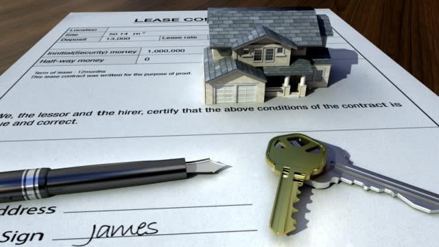 vídeos y material grabado en eventos de stock de construida casa en una firma contrato. - hipotecas y préstamos