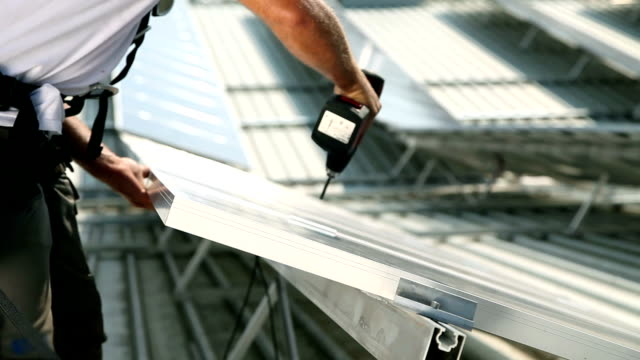 HD CLOSE UP: Constructing solar panels video
