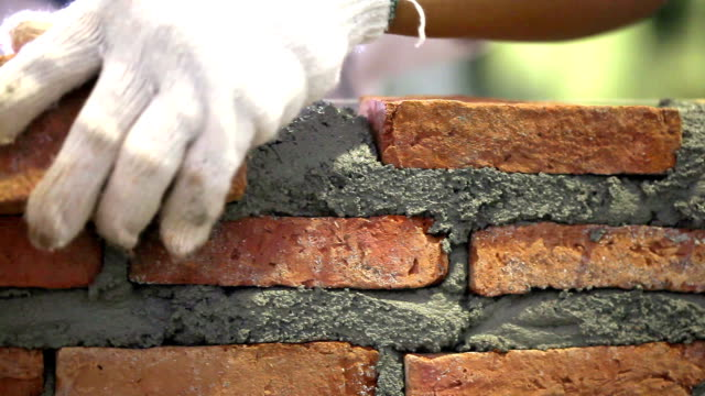 construction brick wall video