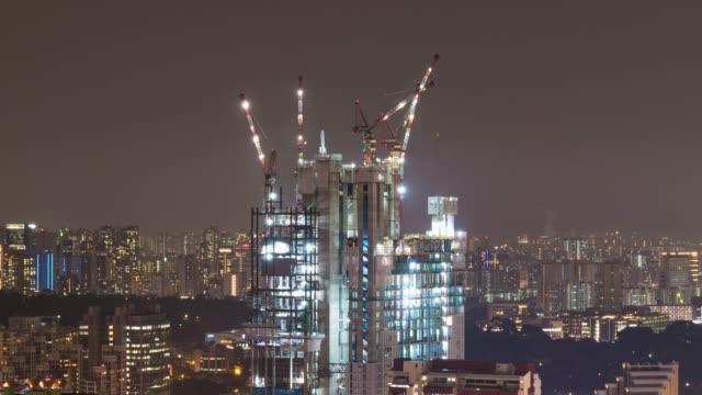 4 k tl: 市で建築。 - クレーン点の映像素材/bロール