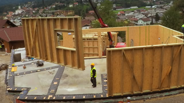 TIME-LAPSE Construction company building a prefabricated home