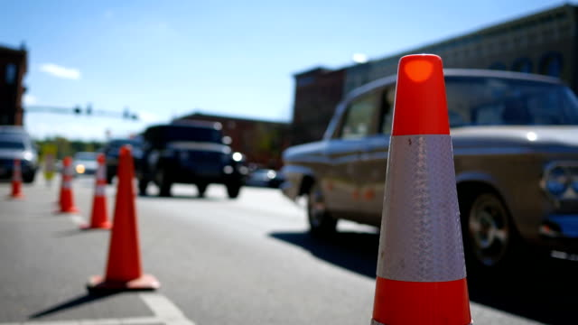 Construction cones blocking a parking spot in small american town video