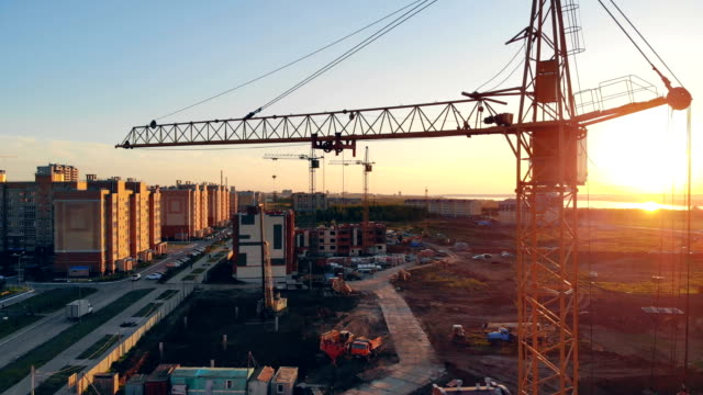 construction crane at a construction site. 4K.