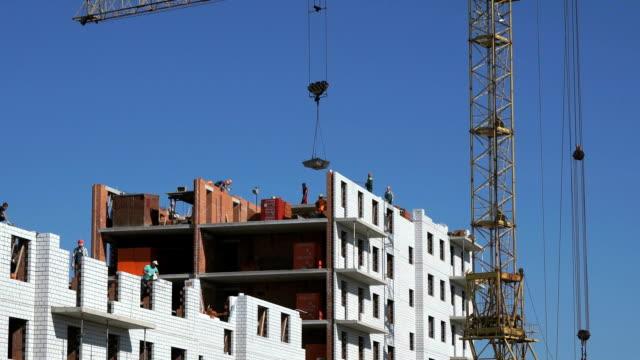 Construction crane delivers a cement for builders video