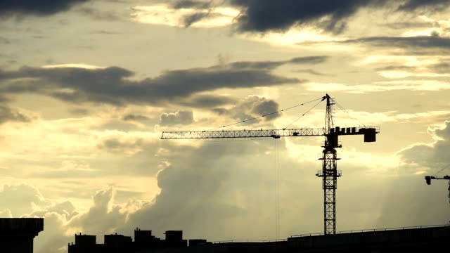 Construction crane working in the clouds HD Video video