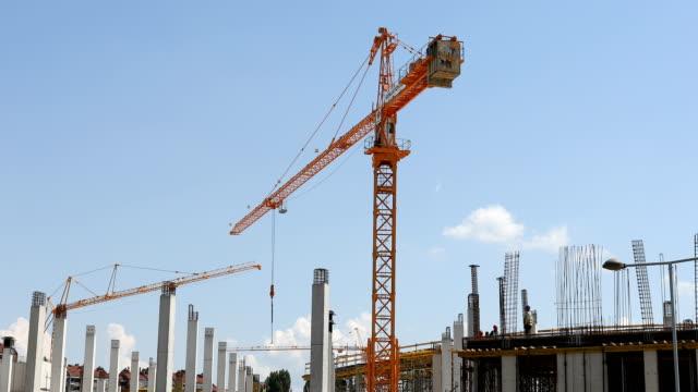 Construction cranes work at construction site video