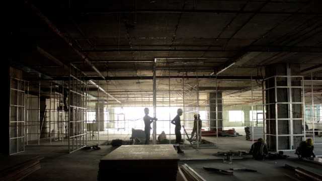 construction crew working together on a building site time lapse - industria edile video stock e b–roll