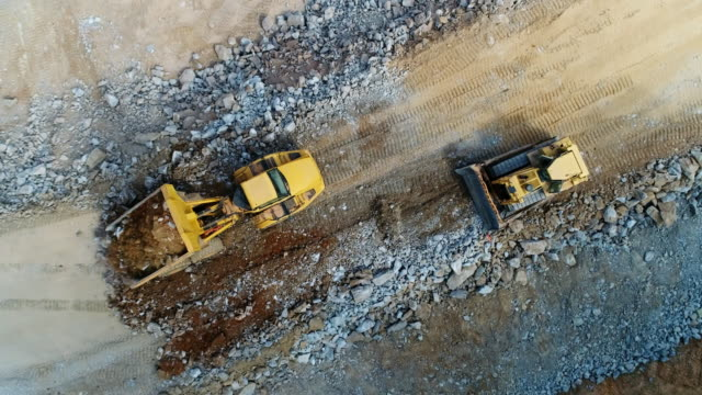 Construction Development Earth movers and construction equipment photographed from drone. construction vehicle stock videos & royalty-free footage
