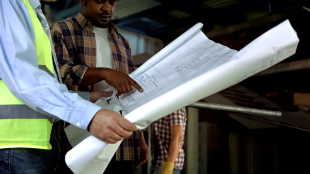 HD DOLLY: Construction Engineer And Foreman Examining Blueprints video