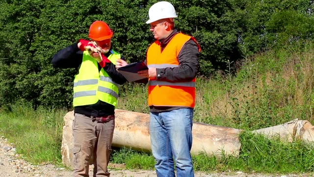 Construction Engineer with documents Construction Engineer with documents handbook stock videos & royalty-free footage