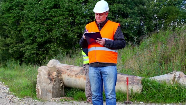 Construction Engineer with folder Construction Engineer with folder handbook stock videos & royalty-free footage