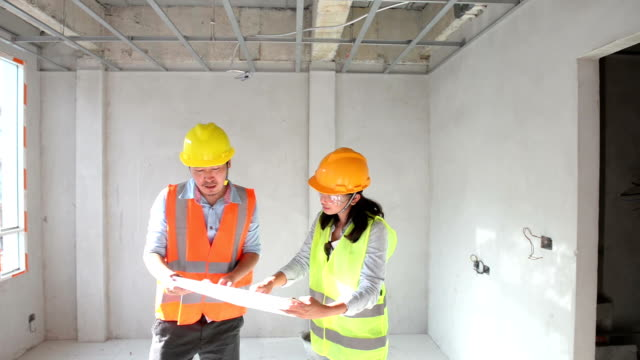 Construction engineers working together in side building planning for the renovation ceiling